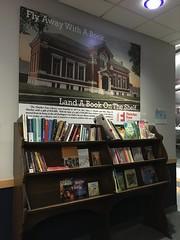 Free Library at Burlington Airport (jessamyn) Tags: burlington burlingtonvt vermont airport btv library freelibrary bookshelf