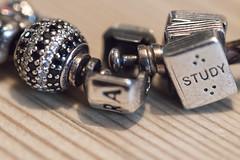 Safety catch on charm bracelet - Macro Mondays (alisonhalliday) Tags: safety sigma105mm macromondays charms bracelet macro closeup odt