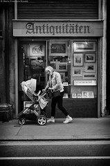 Antiquity vs novelty _IGP8868_cr_ps_cfx_bnw_w (shammuramat (on/off sorry, be bk soon)) Tags: baby antiquity novelty contrast opposite antique pram carriage babycarriage mum mother motherandchild love streetphotography street walk happytimes duality life people blackandwhite blackwhite bnw bn monochrome mono pentax pentaxk01 vienna wien austria smile opposed contrary reverse