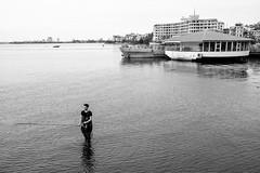 West Lake fisher (gambajo) Tags: vietnam hanoi fisher fisherman fishing lake water man street streetphotography blackandwhite blackwhite hotel westlake fischer see wasser