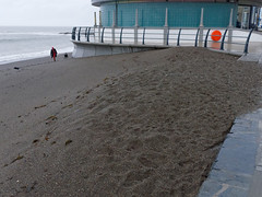 alone on the beach (watcher330) Tags: aberystwyth bandstand sea beach man dog
