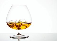 With Bubbles (Karen_Chappell) Tags: glass orange white liquid gold golden booze alcohol bubbles bubble product stilllife drink beverage