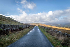 SJ1_4009 - Crag Side Road (SWJuk) Tags: england unitedkingdom swjuk uk gb britain yorkshire northyorkshire yorkshiredales dales wensleydale cragsideroad semerwater burtersett hawes road track drystonewalls hills hillside moors moorland light sunlight shadows grasses valley vanishingpoint bluesky clouds cloudy landscape countryside scenery view nikon d7200 nikond7200 nikkor1755mmf28 rawnef lightroomclassiccc