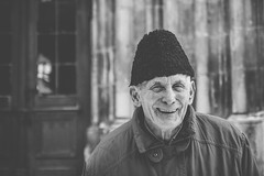 Story moments (Pan.Ioan) Tags: portrait person blackandwhite monochrome smiling headshot warm clothing senior