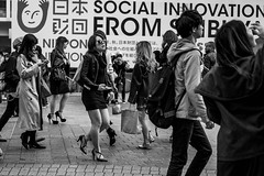 The Fashion Competition Is Fierce In Shibuya Today (burnt dirt) Tags: asian japan tokyo shibuya station streetphotography documentary candid portrait fujifilm xt1 bw blackandwhite laugh smile cute sexy latina young girl woman japanese korean thai dress skirt shorts jeans jacket leather pants boots heels stilettos bra stockings tights yogapants leggings couple lovers friends longhair shorthair ponytail cellphone glasses sunglasses blonde brunette redhead tattoo model train bus busstation metro city town downtown sidewalk pretty beautiful selfie fashion pregnant sweater people person costume cosplay boobs