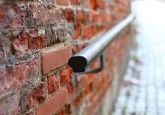 Hold on (Xtraphoto) Tags: handlauf ziegel wand geländer railing