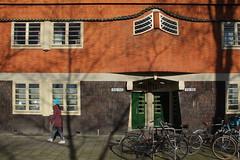 Sunday walking (rob.brink) Tags: amsterdam nederland holland netherlands mokum harbour harbor haven houthavens spaarndammerbuurt het schip michel de klerk architecture urbanism urban city water life orange blue