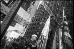 Downtown San Francisco (icki) Tags: ca california october2018 sanfrancisco americanflag blackandwhite flag reflection street