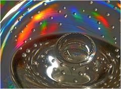 Round and Round they Go! (jesse1dog) Tags: macromondays picktwo glass speckled fuzzy bubbles curves rainbow swirls tabletop macro gm1 olympus zuiko om auto 50mm