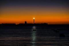 El faro playa de la caleta (ameliapardo) Tags: faro playadeacaleta cadiz andalucia españa fujixt2 fujinon1855 cielo mar agua reflejos rojo azul
