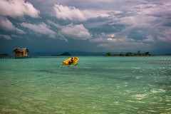 yellow boat (Collin Key) Tags: clouds green landscape storm indonesia sulawesi water gorontalo sky boat seascape yellow saronde texture gorontaloutara indonesien id happyplanet