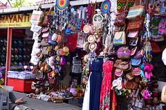 Yet another of the kitschy gift shops on the walkway to Tanah Lot shore temple, Bali (shankar s.) Tags: seasia indonesia java bali islandparadise baliisland touristdestination kutabali shoretemple placeofworship religiousshrine hindufaith hinduism tanahlottemple puratanahlot offshorerocktemple seatemple entrance marketstalls souvenirstalls touristshop touristkitsch street colourful