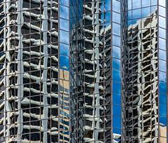 Skyscraper abstract reflections (SpyderMarley) Tags: canada alberta calgary abstract downtown skyscrapers skyscraper sky clouds reflection city buildings cityscape nikond70 nikon1870mm wavypattern