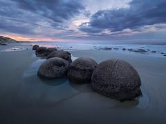 Beach Beads (v-_-v) Tags: new zealand travel ocean moreaki boulders sky waves sunset blue hour tide pool beach clouds drama landscape seascape rocks