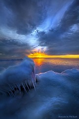 No Winter Skips Its Turn. (Phil~Koch) Tags: dramatic unity trending popular canon rural fineart arts shadow sun sunrise light peace wisconsin shadows endless pastel earth sunlight horizon meadow blue frost frozen pastellakemichigan ice icicles