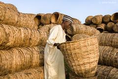 Basket Seller (Irene Becker) Tags: africa arewa imagesofnigeria kaduna kadunastate nigeria nigerianimages nigerianphotos northnigeria selling westafrica basket northernnigeria vendor