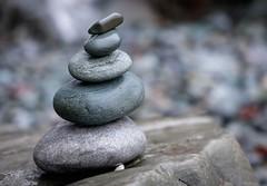 Balance (Karen_Chappell) Tags: rock rocks stones stone pebbles pebble balance stack beach nfld newfoundland middlecove middlecovebeach canada atlanticcanada nature outdoors macro bokeh canonef24105mmf4lisusm avalonpeninsula eastcoast grey