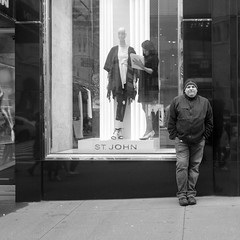 a man, a mannequin, and a mannequin dresser (Zach K) Tags: man mannequin mannequindresser window storefront sales clothing store fifth avenue 5thave nyc new york city midtown black white alliteration manhattan shoppingdistrict standing street candid streetphotography blackwhite bw fujifilm x100f fuji acros