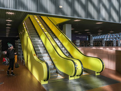 Escalator of lemon-pudding-flavored plastic from the early 00's. (Tim Kiser) Tags: 2000sbuilding publiclibrary library 2004 downtownseattle indoors 2000sarchitecture lemonyellow washingtonstate lemonyellowescalator libraryescalator westernwashington january2019 seattlewashington escalator postmodernarchitecture sunnyescalator 20190126 person yellow downtown woman indoorphotography seattle kingcountywashington remkoolhaus sun january joshuaramus libraryinterior plastic washington westwashington lemonyellowplastic libraryarchitecture yellowplastic 2004building yellowescalator 2019 kingcounty sunnyinterior
