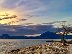 Sunset at Patras, Greece (Shikhasingh1) Tags: sunset sea water nature landscape mountain sky skyline lights colorful