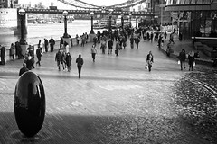 Chocolate Peanut (garryknight) Tags: sony a6000 on1photoraw2018 london themonoseries monochrome blackandwhite copyright allrightsreserved riverside riverthames thequeenswalk cityhall chocolatepeanut peanut sculpture people
