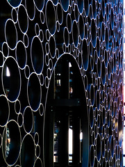 A Micky Mouse Design (Steve Taylor (Photography)) Tags: mickymouse architecture design contrast black blue mauve white metal newzealand nz southisland canterbury christchurch cbd city circle ring round shiny thecrossing facade