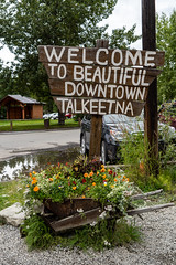 AUGUST 7 2018  - TALKEETNA, AK: Quirky sign welcomes visitors to beautiful downtown Talkeetna, a small city in central interior Alaska (m01229) Tags: alaska ak nature water denali mtmckinley glacier destination trees talkeetna alaskarange scenic outdoors america valley view peaks winter nationalpark mountains landscapes talkeetnamountains clouds denalinationalpark scenery beautiful travel sky train green landscape park usa summer wilderness mountain