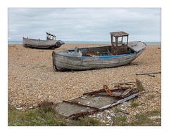 Abandoned Fishing Boats, Dungeness, Kent, England. (Joseph O'Malley64) Tags: abandonedfishingboats abandoned neglected derelict dungenessbeach dungeness kent england britain british greatbritain beach coast coastal sea seaside thebritishseaside gravel shingle boats fishingboats fishing seafishing fishingindustry desert deserthabitat britainsonlydesignateddesert clinkerbuilt clinkerbuiltboats clinkerbuiltfishingboats wooden woodenboats boatparts scrap scrapmetal ferrousmetals detritus woodenpanels grass coastalgrasses desolate expanse newtopography newtopographics manmadestructures fujix fujix100t accuracyprecision documentaryphotography britishdocumentaryphotography