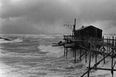 The new trabucco (ndrearu) Tags: water bw outside film blue beach sky italy wind sea waves ilford hp5