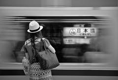 Nihonbashi (reiko_robinami) Tags: streetphotography station urban train platform monochrome blackandwhite oneperson tokyo japan woman