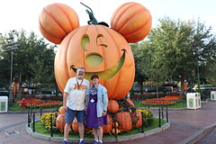 "Tracey and Scott with the Giant Mickey Pumpkin • <a style=""font-size:0.8em;"" href=""http://www.flickr.com/photos/28558260@N04/45787187612/"" target=""_blank"">View on Flickr</a>"