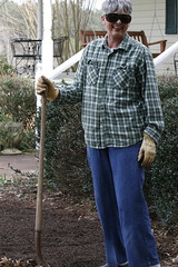 Martha Coleman stands with a shovel outside her house.