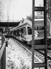 837 II (Mikael Neiberg) Tags: railway railroad train lähijuna helsinki snow winter pentax645 ilforddelta3200 grain bw monochrome explored