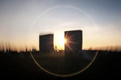 Leytonstone twins (jrockar) Tags: london leytonstone architecture surreal surrealism lensflare flare x100f fuji fujix fujifilm halo sunset jrockar janrockar neverwhere silhouette building motion blur motionblur landscape cityscape
