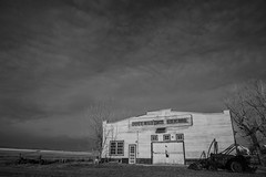 Queenstown Garage (Neil Young Photography (nyphotos.ca)) Tags: nowhere alberta canada queenstown garage 1920s fotoman nyphotos neilyoung neilyoungphotography blackandwhite bw monochrome