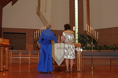 """Mrs. Morton and Mrs. Miller Lighting the Family Candles • <a style=""""font-size:0.8em;"""" href=""""http://www.flickr.com/photos/109120354@N07/46054216842/"""" target=""""_blank"""">View on Flickr</a>"""