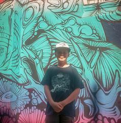 Graffitti Kid (BunnySafari) Tags: yashicamat124g sydneybackstreets darwin 2017 wisteria australia porta160 sydney film october bunnysafari