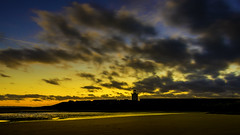 sunset (stevenbailey7) Tags: sunset sunsets nikon nikkor landscape new light cloudscape clouds sky skyscape dusk evening nature wales colour colourful lighthouse yellow black blue beach seaside travel coast walescoast sand silhouette shadows november winter afternoon naturephotography sunsetsky walk outside photography