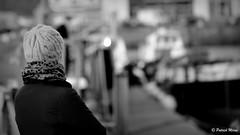 Wool cap (patrick_milan) Tags: wool cap girl portrait bokeh quay black ship marine water