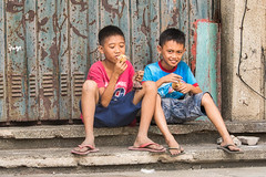 Snack Time (Beegee49) Tags: street boys children city sitting eating snack panasonic fz1000 happy planet young bacolod philippines asia happyplanet asiafavorites