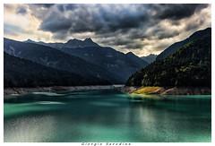 sauris lago (Giorgio Serodine) Tags: lago sauris carnia friuli montagne acqua canon cielo nubi pini alberi allaperto controluce ombre riflessi