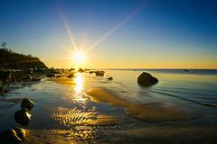 Sunset (lablue100) Tags: colors sun sunset sea water sound rocks boulders sunburst landscapes lowtide beauty action