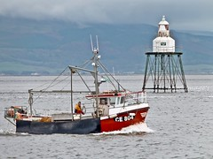 Steaming past the lighthouse, Lough Foyle. (willieguildea) Tags: boat fishingboat water waterscape coast coastal lighthouse movillelighthouse lough loughfoyle river moville donegal ireland eire coastalireland