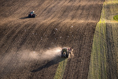 working on the field (Rafael Zenon Wagner) Tags: traktor acker feld geometrie arbeit deutschland ostsee nachmittag struktur nikon d810 200mm tractor acre field geometry work germany baltic afternoon texture