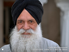 2018-10b Sikhism in Amritsar (26) (Matt Hahnewald) Tags: matthahnewaldphotography facingtheworld people character head face smilingeyes laughlines expression smile highspirits beard fullbeard dastar turban consent fun respect concept humanity living culture tradition lifestyle happiness joy religion religious traditional cultural temple gurdwara devotee worshiper pilgrim goldentemple amritsar punjab india asia asian indian punjabi individual oneperson male old man photo detail physiognomy nikond610 nikkorafs85mmf18g 85mm 4x3ratio resized 1200x900pixels horizontal street portrait closeup headshot cropped fullfaceview black outdoor posing authentic smiling positive clarity sikh sikhism colour