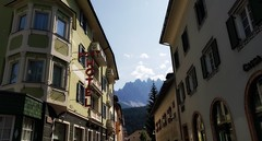 Innichen/San Candido (Eternally Forgotten) Tags: südtirol south tyrol tirol italy italia italien italian province bozen bolzano innichen sancandido pustertal valpusteria mountains alps dolomites little town hamlet city dorf bilingual art architecture culture germanic horizon sky skies empty serenity tranquillity peace calm feelings simple beautiful still journey travel tourism trip discovery voyage adventure exploring hiking wandering magic spell enchanting memories recollections lovely dreams melancholy yearning nostalgia reminiscence downtown center hotel street high rising gemeinde