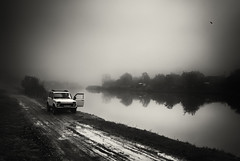 niva (Pomo photos) Tags: car fisherman fishing old lake river water landscape mist misty fog tree land road dirt morning dusk winter ground door grass reflection leicax1 surreal mood art sepia brown monochrome mono blackandwhite blackwhite black bw puddle mud