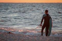 Surfing in Naples (isabellamcd99) Tags: naples florida landscape surf water pier waves board man sunset ocean blue orange