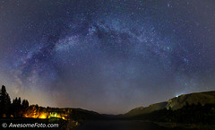 Milky Way over lake (james c. (vancouver bc)) Tags: light night northvancouver bc grass canada arch panorama panoramic landscape park mountain outdoor peaceful sky tree vancouver water britishcolumbia lighthouse blue green yellow orange starburst starfield atmosphere background cluster constellation galaxy infinite milkyway nature outdoors science lake space star starry stellar twinkle universe vast