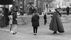 wizarding battle 01 (byronv2) Tags: edinburgh edimbourg blackandwhite blackwhite bw monochrome peoplewatching candid street bristosquare harrypotter fantasy books wizard wizards wizardbattle wand magicwand man woman